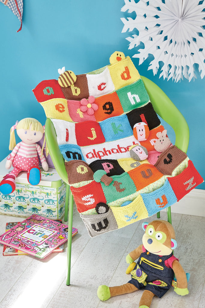 Nursery knitted wall hanging with letters of the alphabet pockets and toys