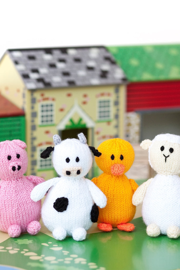 Knitted farmyard friends pig, cow, duck and sheep
