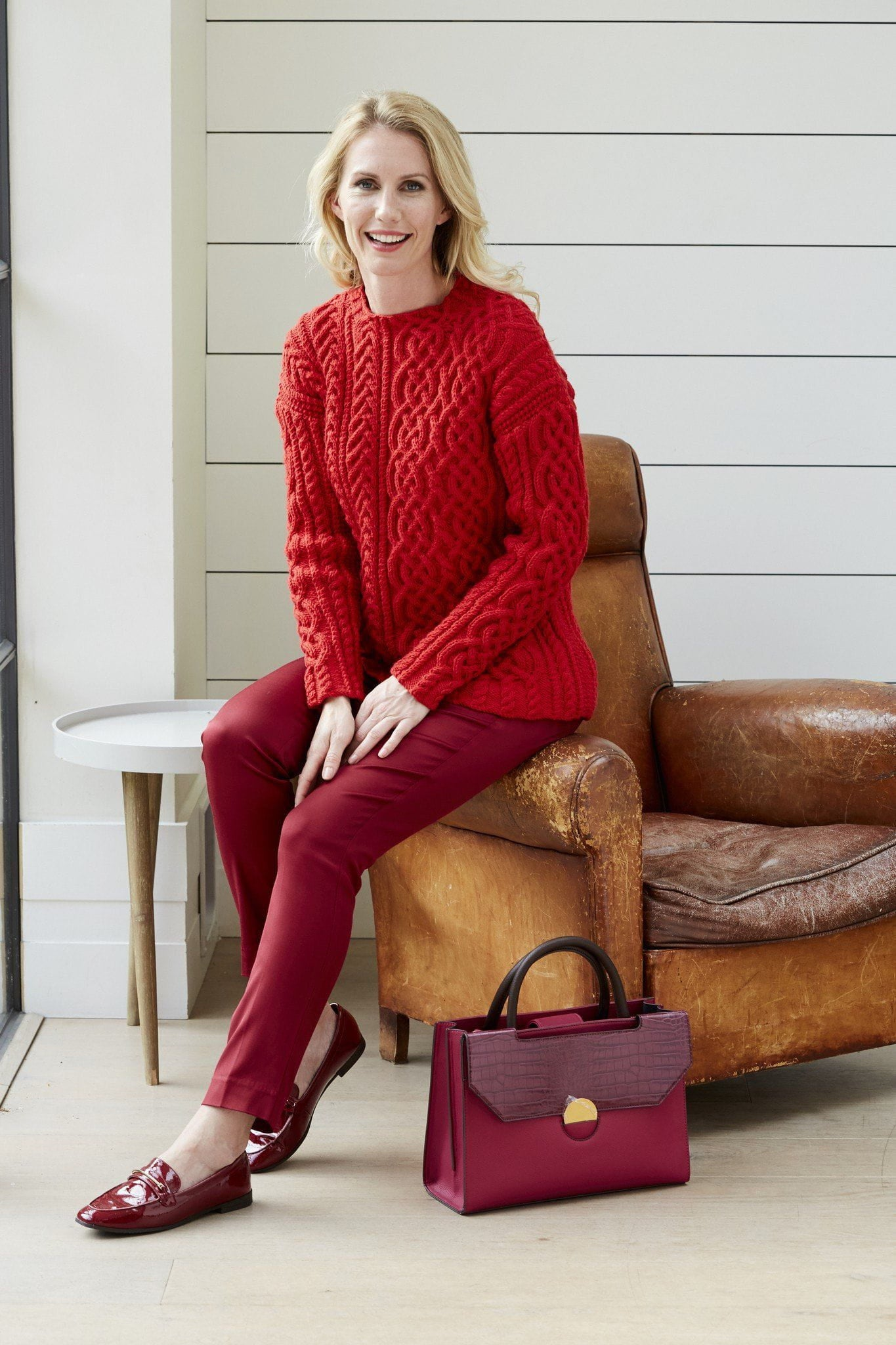 8289ad905ee4 Ladies red asymmetrical cable sweater knitting pattern. Woman s Weekly