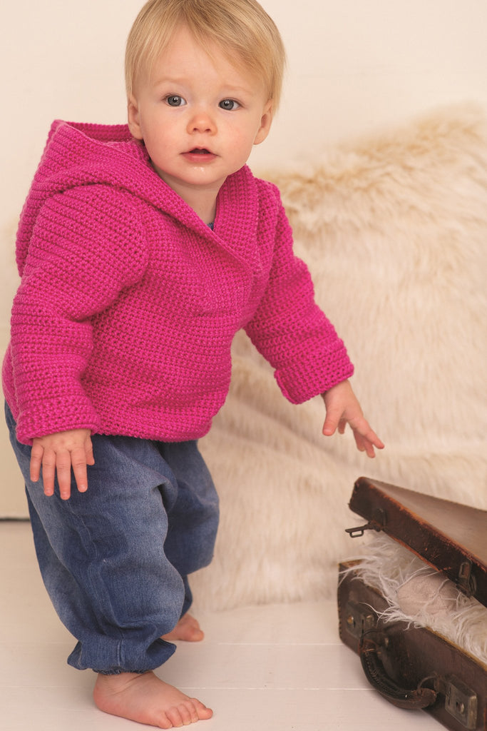 Crocheted top with hood for a baby in bright pink yarn