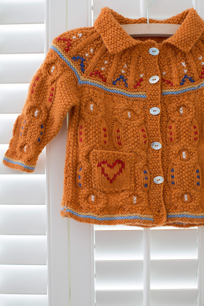 Knitted baby's cardigan with embroidery