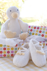 Sweet booties for babies and cheeky duck toy in white and cream