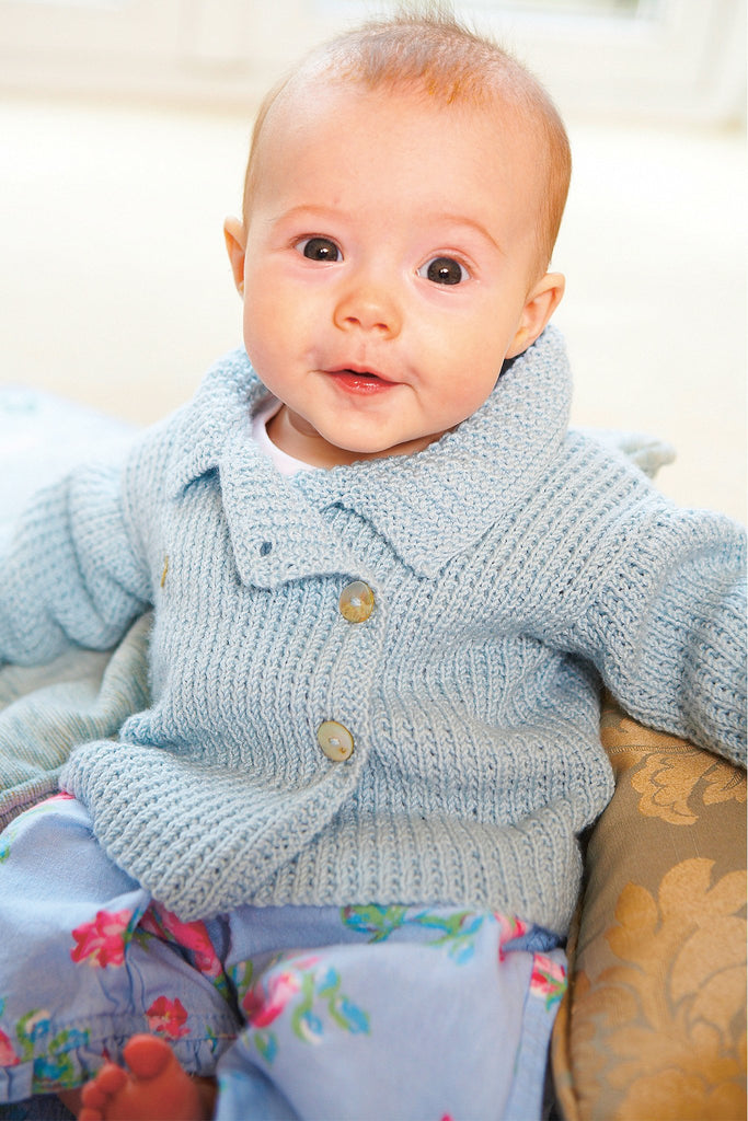 Baby's knitted retro jacket with buttons to one side and cute collar