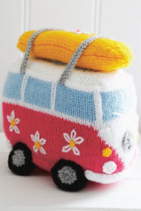 Knitted jolly camper van toy with surfboard strapped on roof