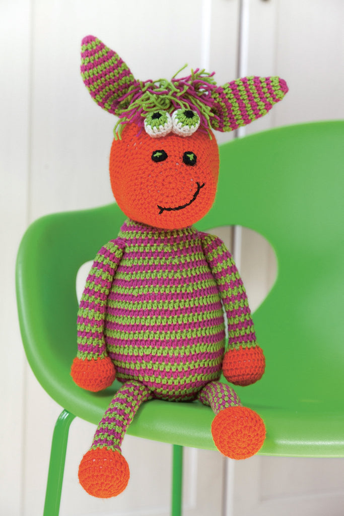 Bright and quirky striped crocheted horse with boggle eyes