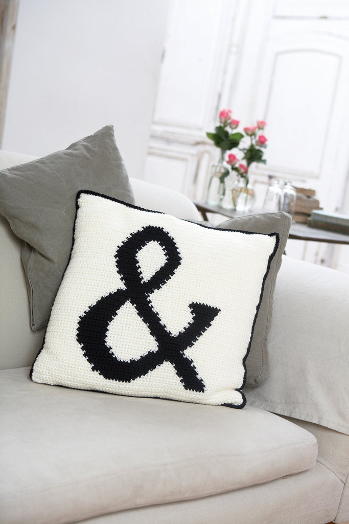Crochet cushion with ampersand as part of the design