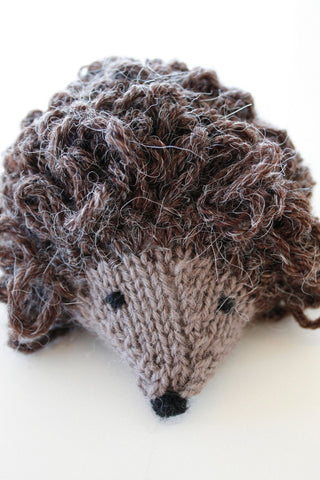 Small knitted hedgehog toy