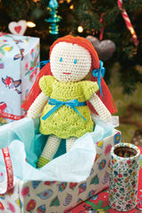 Crochet toy doll with red hair