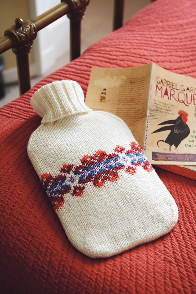 Knitted cover for hot water bottle with ribbed neck and Fair Isle motif