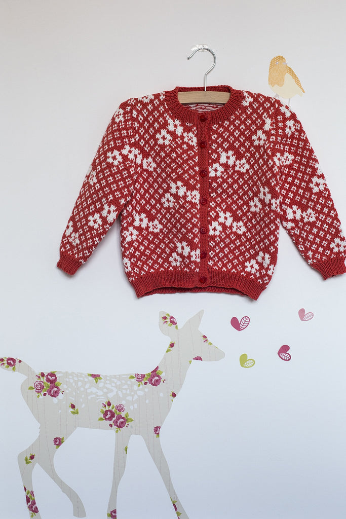 Knitted cardigan for girls with flower motif