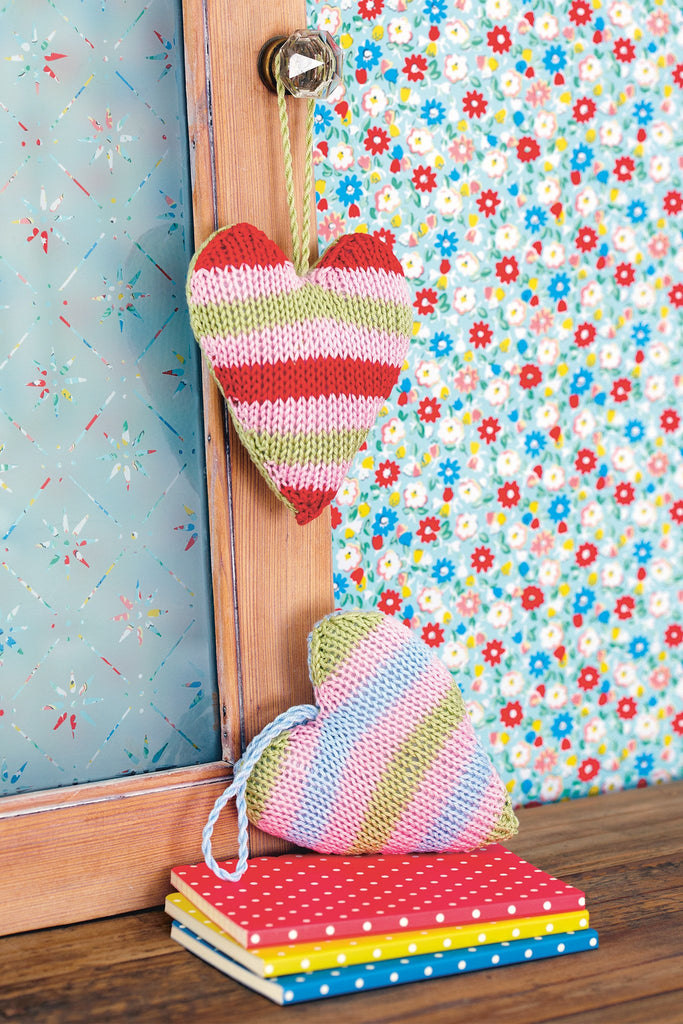 Two stuffed striped knitted hearts with hanging thread loops