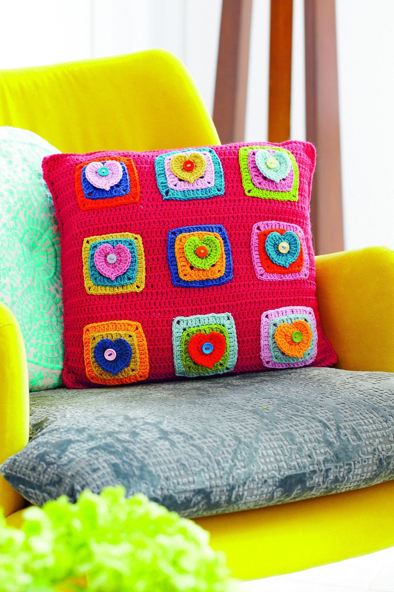 Heart cushion crochet pattern the knitting network colourful crocheted cushion with hearts bankloansurffo Gallery