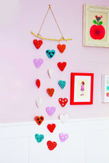 Hanging mobile with crochet hearts