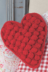 Bold heart crochet cushion with big bobbles and neat trim