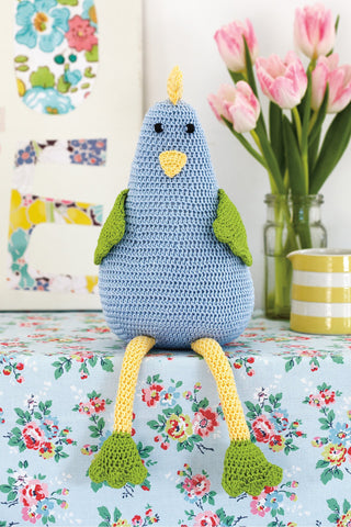 Crocheted toy hen in blue, yellow and green