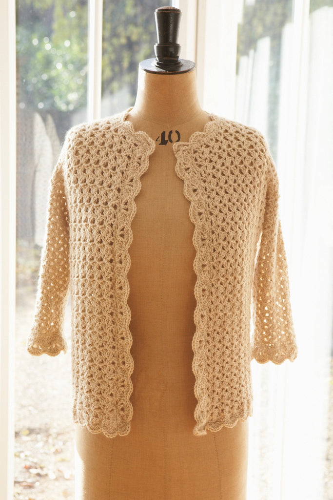 Women's crochet cardigan with three-quarter sleeves