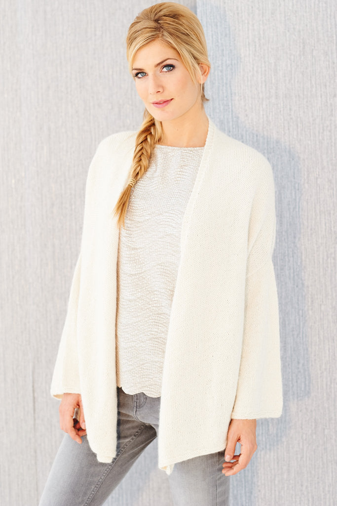 Knitted women's cardigan in soft alpaca white yarn with open front