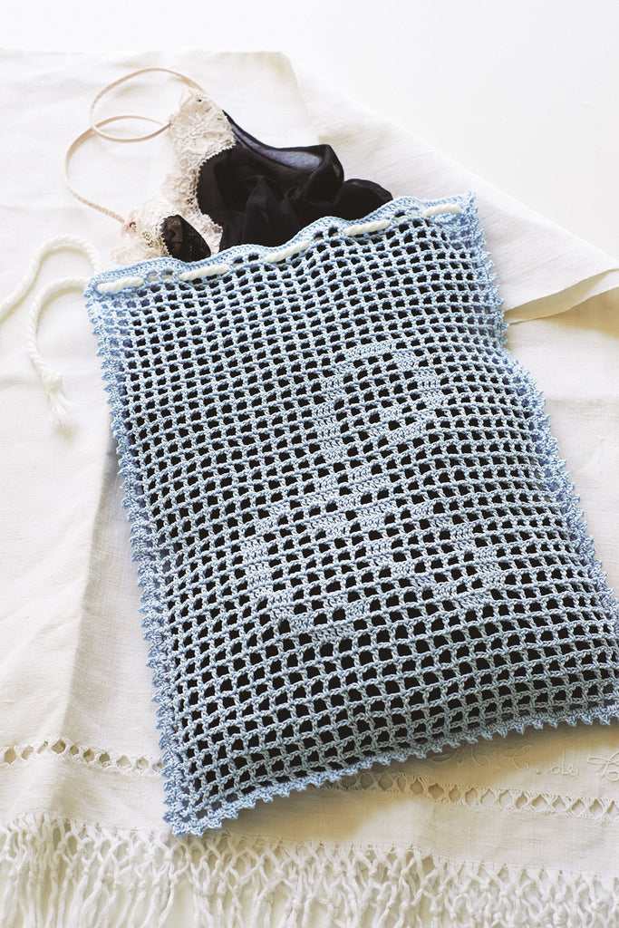 Crochet wash bag for laundry with motif design to pop in washing machine