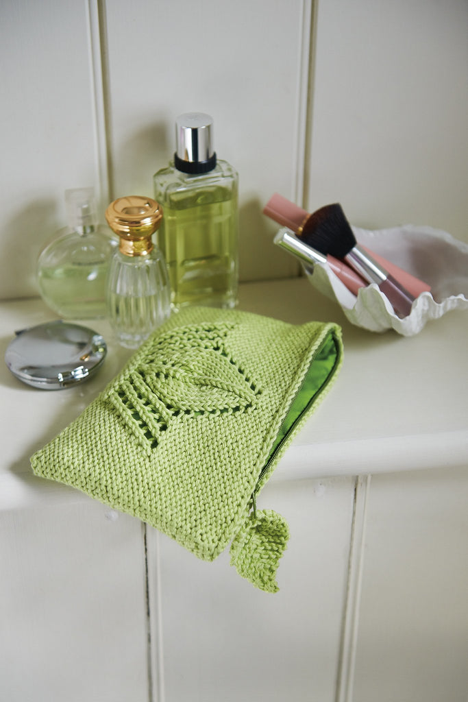Knitted makeup bag with leaf lace design and leaf pull for zip