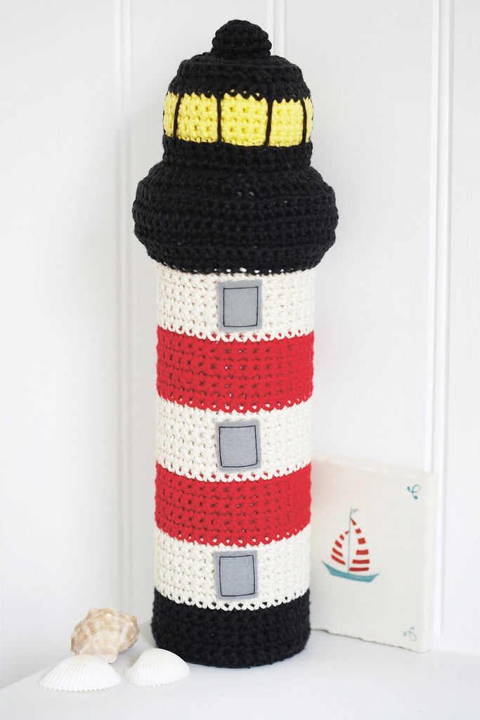 Crocheted lighthouse doorstop or toy with bold stripes