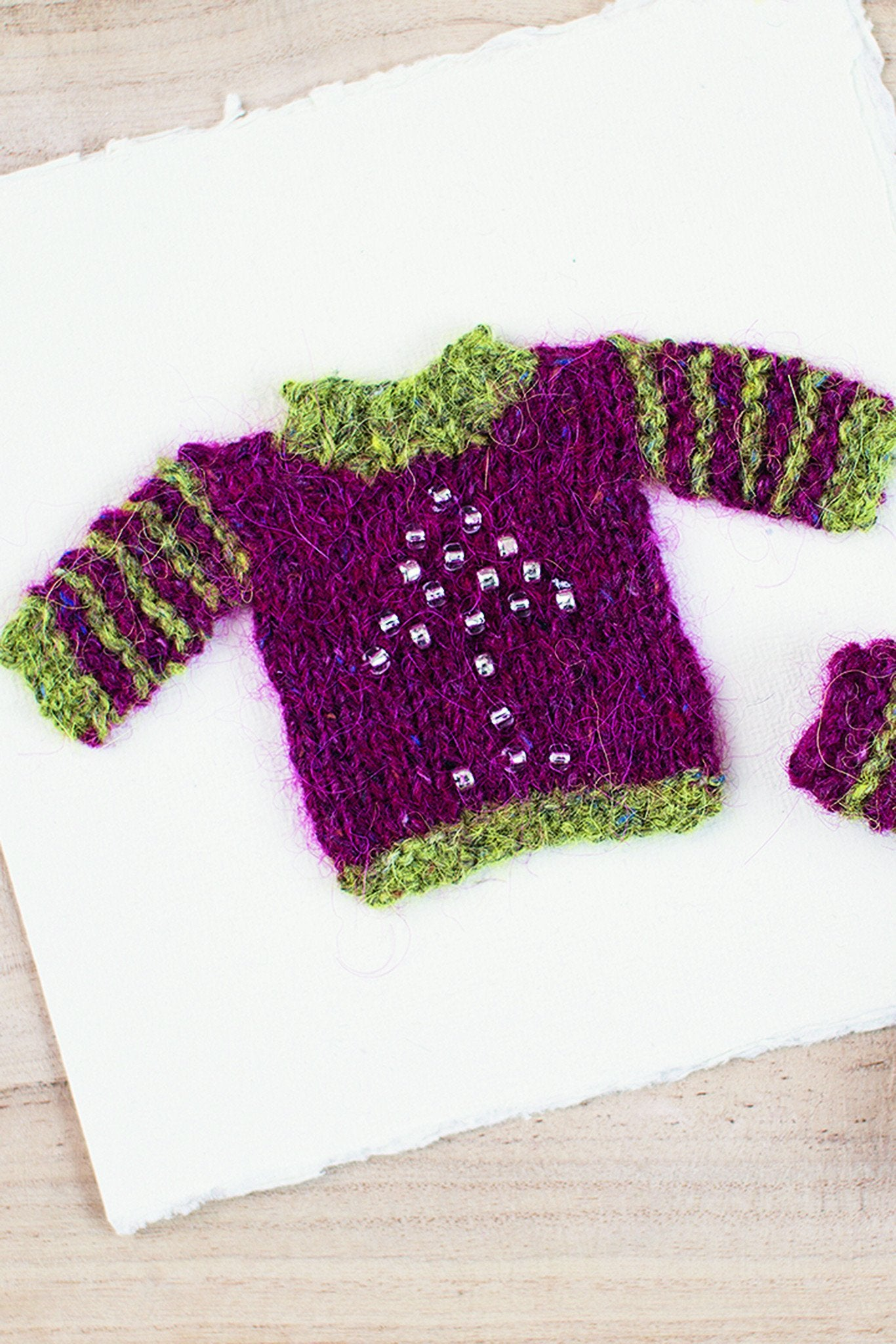 Mini christmas jumper knitting pattern the knitting network small knitted christmas jumper with beads bankloansurffo Image collections