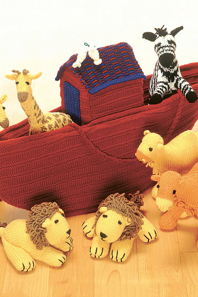 Toy knitted Noah's Ark with boat animal passengers in pairs