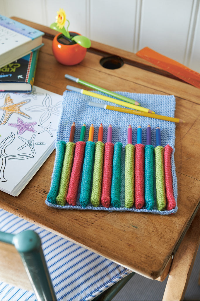 Knitted pencil case with individual narrow pockets for each pencil