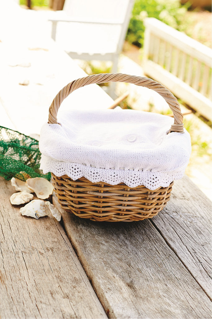 Fresh white knitted picnic basket cover with pretty trim