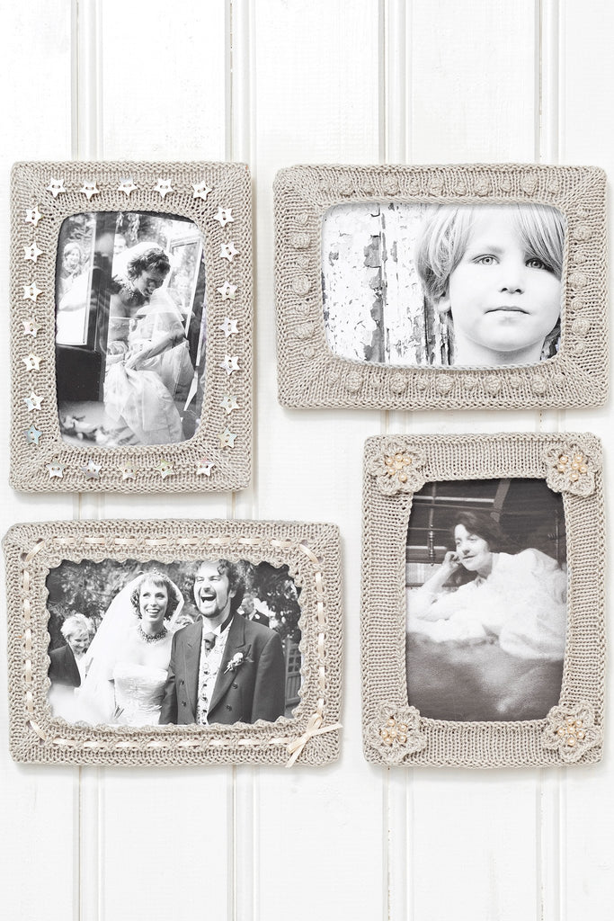 Four knitted picture frames with a variety of embelishments