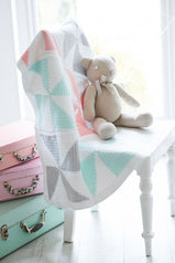 Crocheted baby blanket with pastel pinwheel pattern