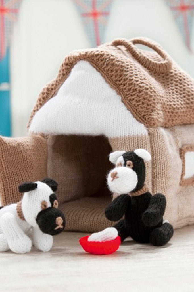 Two knitted two-tone puppies with their own kennel and food bowl