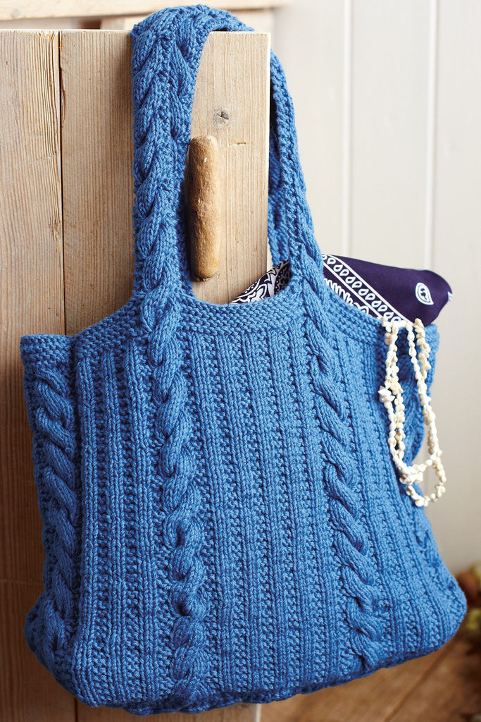 Knitted bag with cable handles and verticle cables and ribs