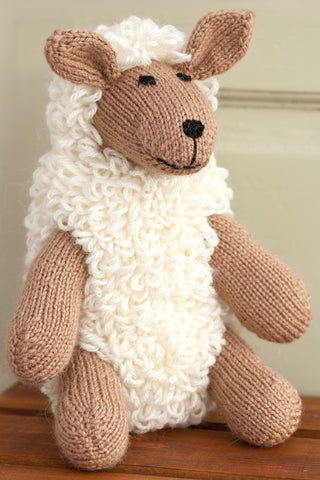 Loopy knitted sheep toy with perky ears and happy face