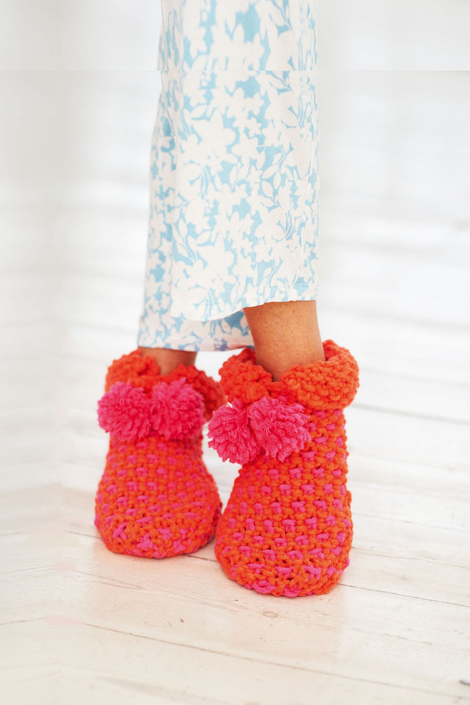Knitted and crocheted bootee style slippers with pom-poms