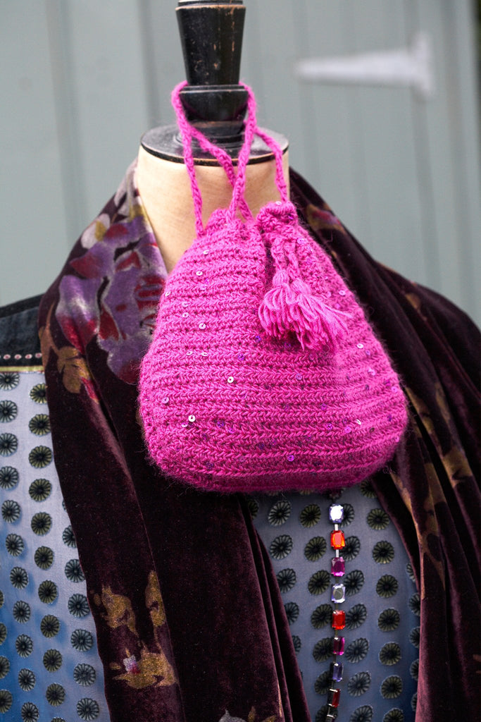 Crochet pouch evening bag with drawstring neck and decorative tassel
