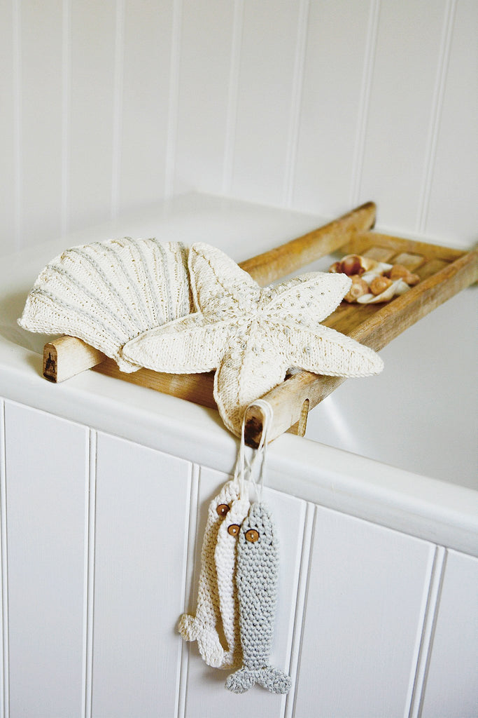 Seaside bathroom set with knitted shell and starfish with crochet sardines