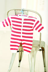 Striped babygro knitted with pink and white stripes