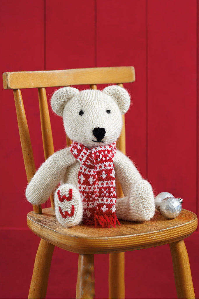Knitted Woman's Weekly teddy bear toy with red and white Fair Isle style scarf