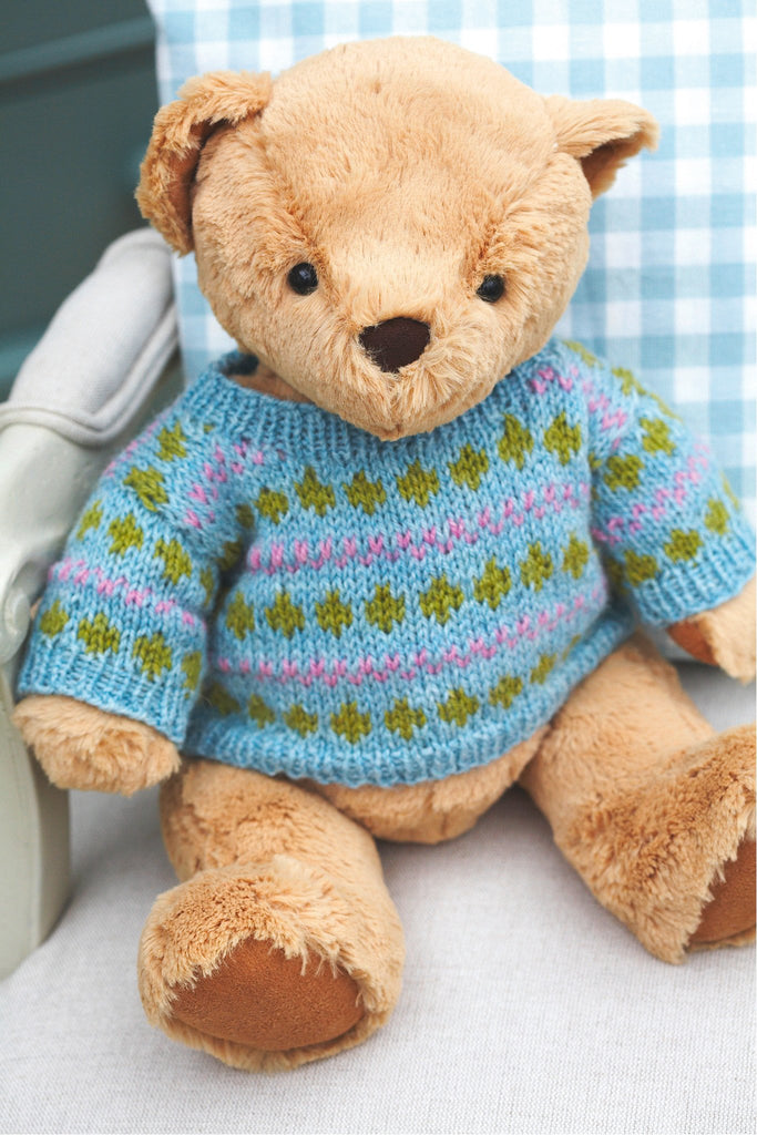 Knitted teddy bear sweater with design of stripes and diamonds