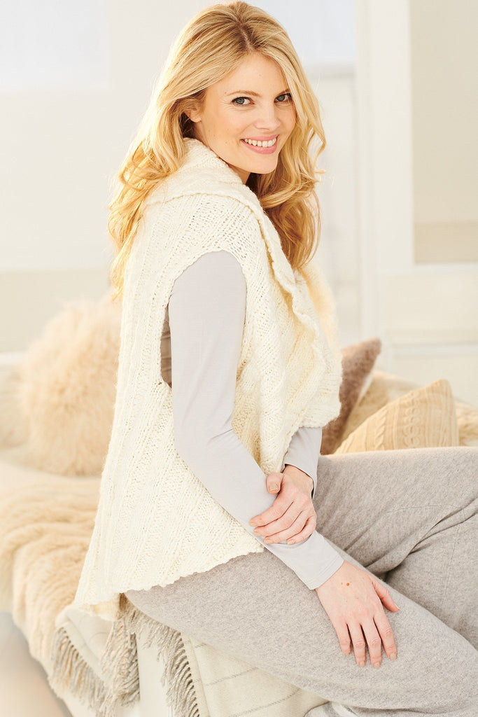 Knitted gilet jacket for women with deep collar and dipped back