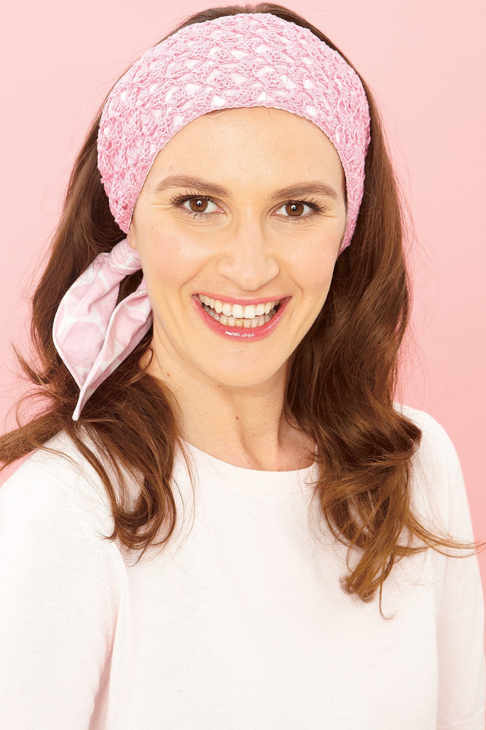 Crocheted ladies' headband in pretty pink