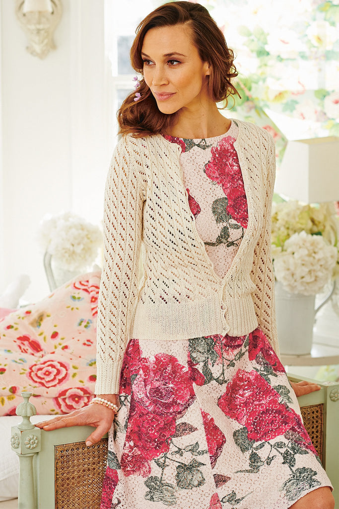 Feminine lace knitted cardigan with long sleeves in cream