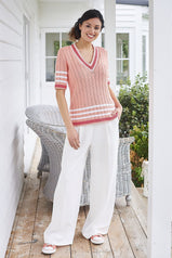 knitted ladies cricket jumper in peach with stripes