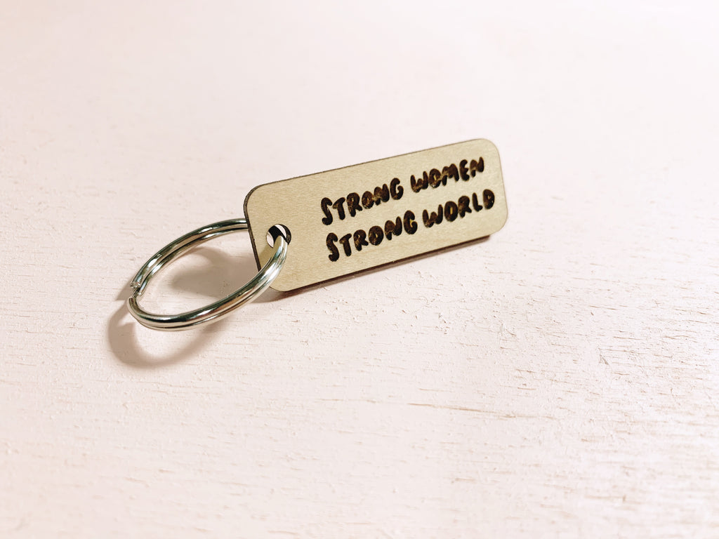 Strong women strong world laser cut keychain - Craft Boner