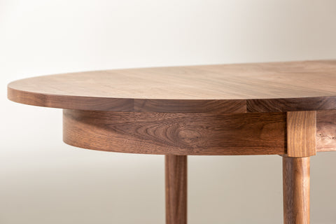 Curve of Highland Dining Table in walnut