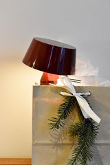 Red Bicoca lamp in Christmas gift bag