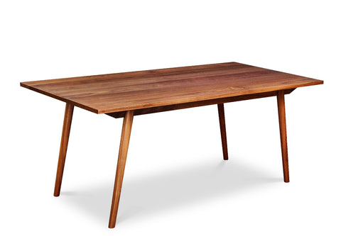 Mid-century modern Fjord Dining Table with angled legs in walnut