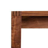Finger joinery on corner of walnut Harbor Dining Table from Chilton Furniture in Maine