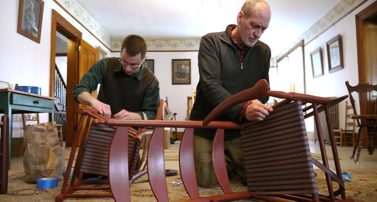 Adam Nudd-Homeyer and Brother Arnold Hadd weaving seats on the Alfred Chairs. Photo: United Society of Shakers