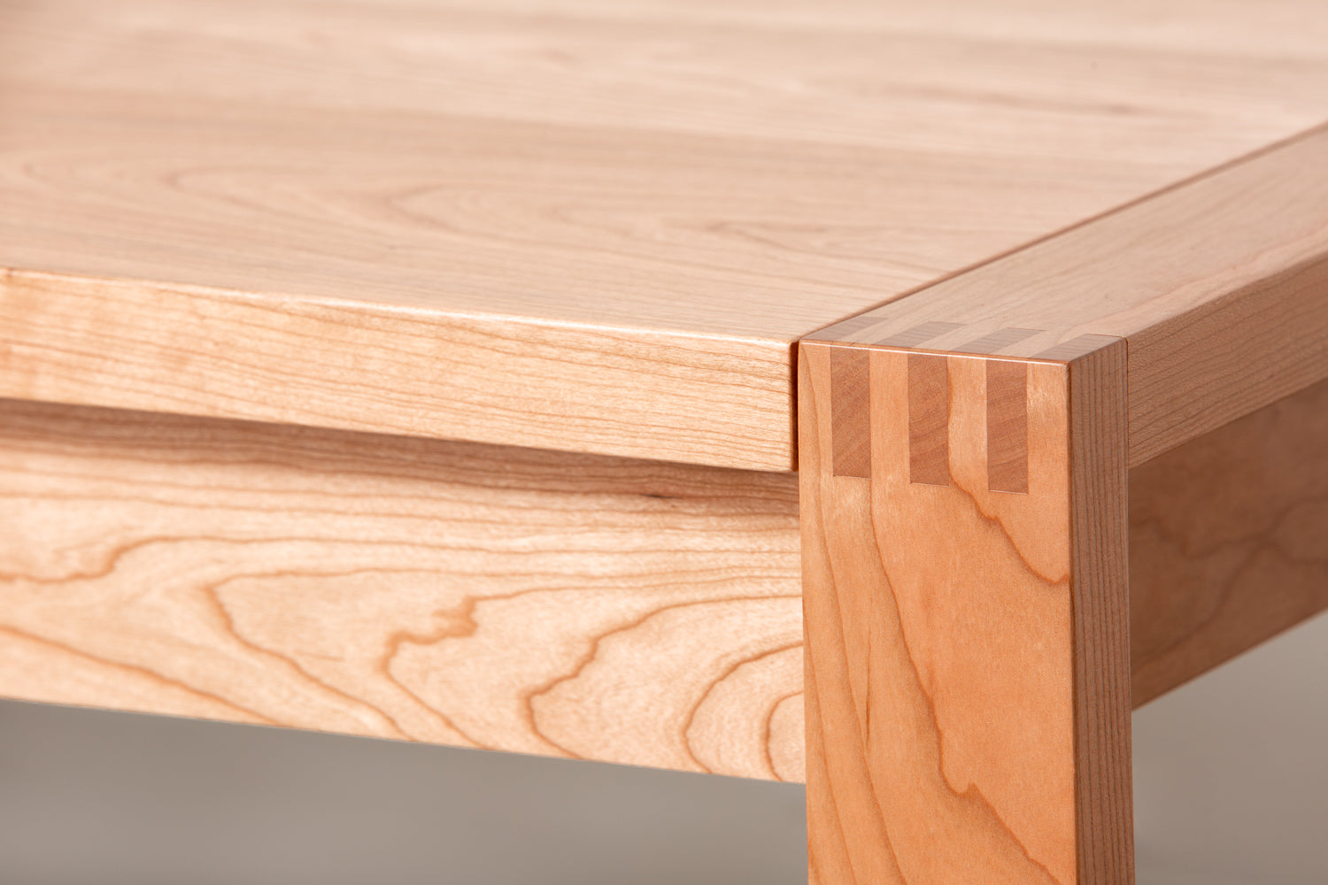 Close up of finger joints on a modern wood Parsons table from Chilton Furniture.